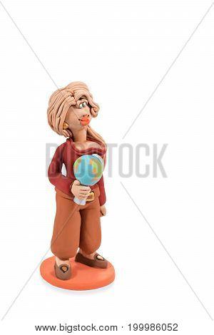 Clay statuette of geography teacher with globe in hand isolated on white background