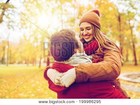 love, relationships, season and people concept - happy young couple meeting in autumn park