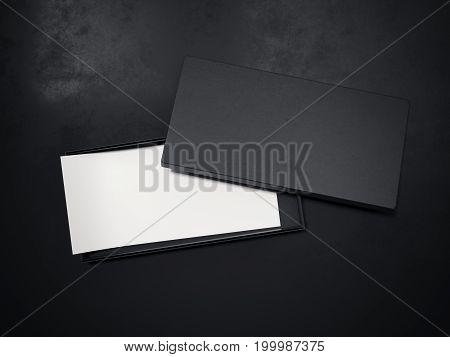 Blank black box with white flyer on dark floor. 3d rendering