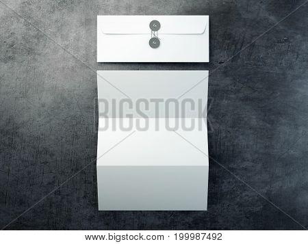 Blank leaflet and white envelope on dark floor. 3d rendering