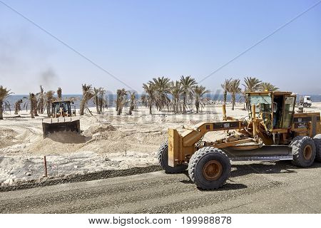 Dubai, United Arab Emirates - May 03, 2017: Heavy Duty Vehicles At The Construction Site Along The R