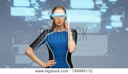 augmented reality, science, technology and people concept - beautiful woman in futuristic 3d glasses with virtual screens projection over blue background