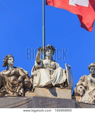 Zurich, Switzerland - 20 July, 2016: sculptures on the top of the Zurich main railway station building above its main entrance. Zurich main railway station building was designed by architect Jakob Friedrich Wanner, opened in 1871.
