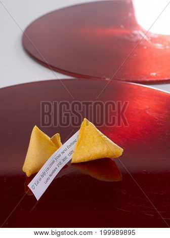 Broken Fortune Cookie on a Red Plate