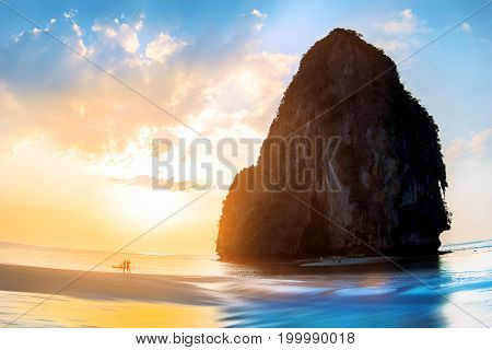 Sunset on the beautiful beach in the province of Krabi. Railay Beach. Thailand. Blue and yellow colors image.