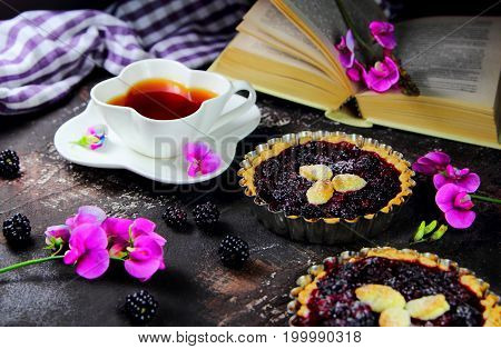 BlackBerry quiche with flowers and Cup of tea.Breakfast in bed
