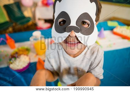 Boy pretending to be a dog during birthday party at home