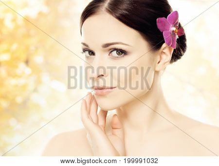 Portrait of young, beautiful woman over autumn background.