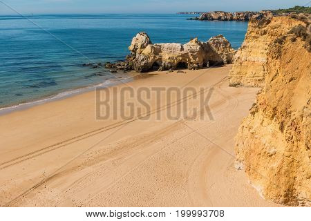 Scenic golden cliffs near Alvor Portimao. This beach is a part of famous tourist region Algarve