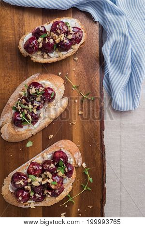 Toasts with goat cheese grapes nuts and honey