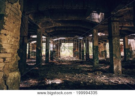 Empty ruined hall of abandoned warehouse, toned
