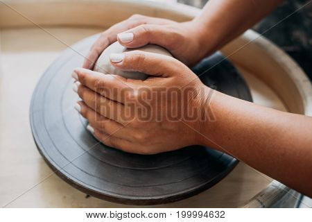 Pottery wheel, clay, woman's hands, potter is going to work in pottery, selective focus
