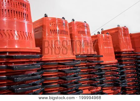 Red plastic stacked shopping basket isolated on white background