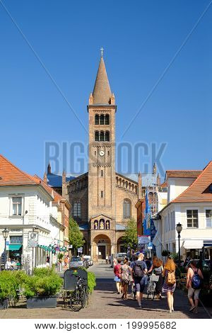 POTSDAM GERMANY - AUGUST 15 2017: View on the Brandenburger Street and Peter and Paul Church - Peter-und-Paul-Kirche - in Potsdam.