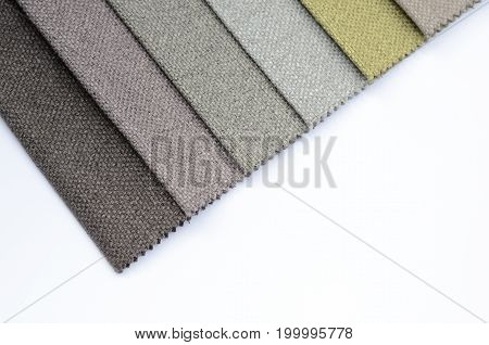 Bright collection of colorful gunny textile samples. Fabric texture backdrop with space for text