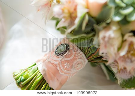 Elegant wedding flower bouqet on texture white background close-up
