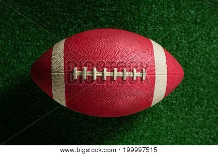 Close-up of American football on artificial turf