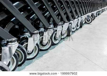 Close-up Group Of Shopping Cart Wheels. Selective Focus.