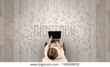 Letters with writer using tablet in a beige chair and an office space