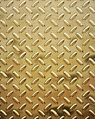 a very large sheet of roughened gold tread or diamond plate poster