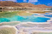 The evaporated salt. Reduced water in the very salty Dead Sea. Therapeutic Dead Sea, Israel. The concept of medical and ecological tourism poster