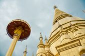 Large golden temple with sky background, Name is Phra Maha Chedi, Phra Maha Chedi Srivang Chai, Golden temple for buddhism to pray for faith poster