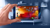 Augmented reality application of smartphone that lets you place virtual furniture to your real home before buying. Man holding smartphone in hand horizontally. poster