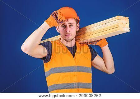 Carpenter, Woodworker, Labourer, Builder Carries Wooden Beam On Shoulder. Woodworker Concept. Man In