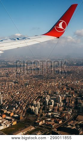 Istanbul, Turkey - February 2, 2019: Wing Turkish Airlines Airplane On The Sky Above Istanbul At Sun