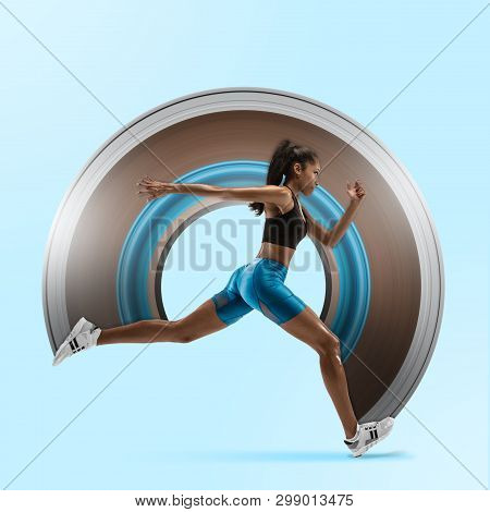 Young african woman running isolated on blue studio background. One female runner or jogger. Silhouette of jogging athlete. Concept of healthy lifestyle, sport, movement, action. Abstract design. poster