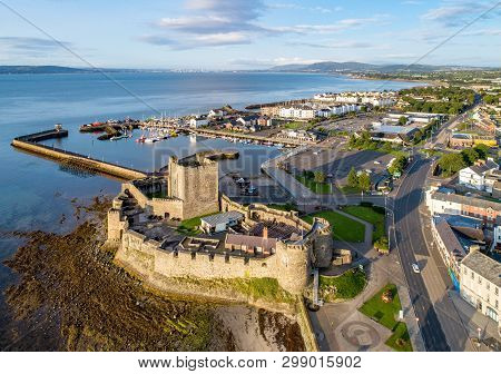 Belfast Lough. Medieval Norman Castle In Carrickfergus  In Sunrise Light. Aerial View With Marina, Y