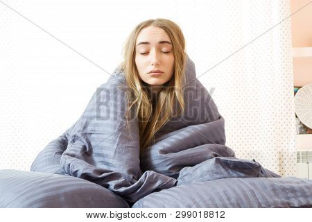 Sleepy Girl In The Morning In Bed, Young Beautiful Woman Sleeping Wrapped In A Blanket. Sleepy Beaut