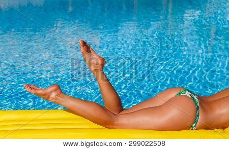 Portrait Of Sexy Tanned Slim Model Woman In Colorful Bikini And Hat Having Relax And Enjoying In Swi