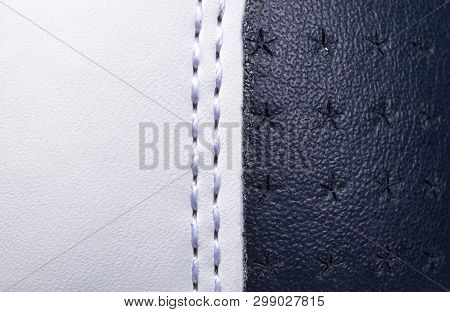 Blue And White Perforated Leather Texture Background. White And Blue Leather With Stitching Close Up