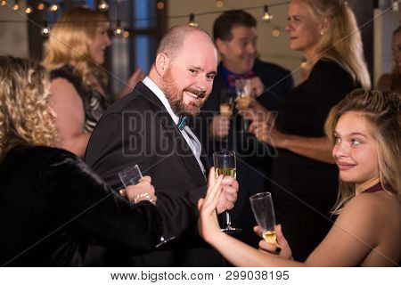 Handsome Man With Friends On The Dance Floor