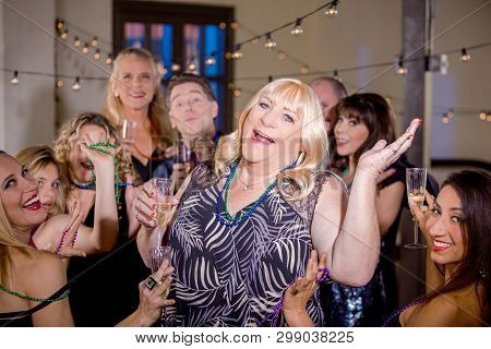 Trans Woman Dancing At A Party With Friends