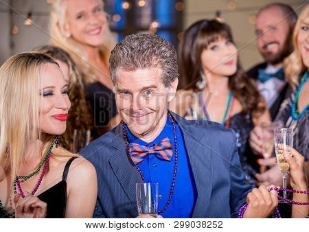 Funny Man Dancing At Party With A Pretty Woman