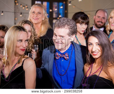 Funny Handsome Man At A Party With Two Pretty Women