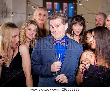 Funny Handsome Man At Party With Beautiful Women