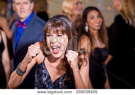 Frustrated Mature Woman Screaming At A Party