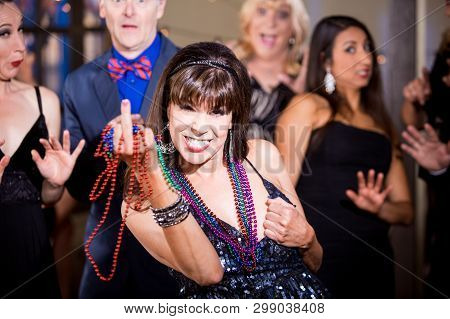 Obnoxious Woman With Beads Makes A Rude Gesture