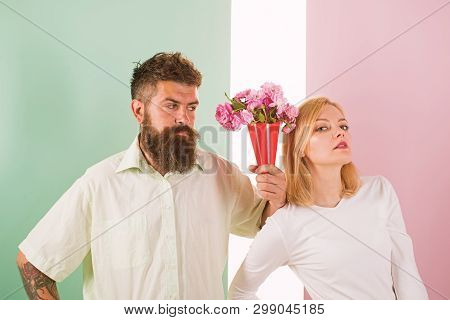 Hipster Bearded Give Bouquet Flowers Girl Excuse Gesture. Man With Beard Apologyes Woman. Couple Dat