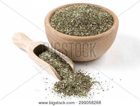 Green Savory Mix Or Chubritsa In Wooden Bowl And Scoop Isolated On White Background. Spices And Food