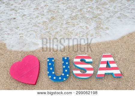 Patriotic Usa Background With Decorations On The Sandy Beach