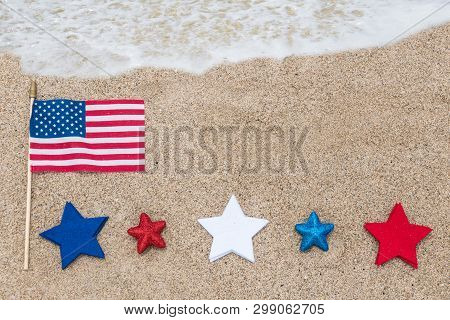 Patriotic Usa Background With Flags And Decorations On The Sandy Beach