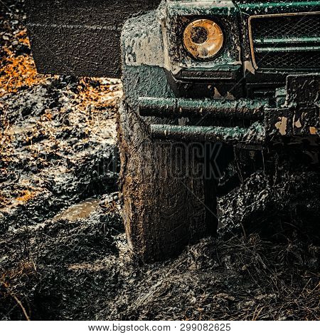 4x4 Travel Trekking. Offroad Vehicle Coming Out Of A Mud Hole Hazard. Off-road Travel On Mountain Ro