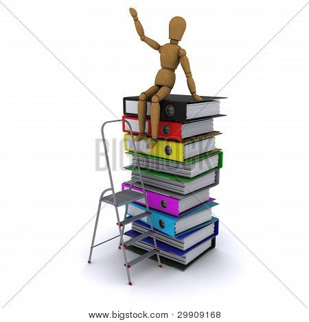 The wooden man climbed the ladder on the stack of books
