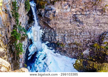 The spectacular ice and snow cone in winter at the bottom of Spahats Falls on Spahats Creek in Wells Gray Provincial Park near the town of Clearwater, British Columbia, Canada poster