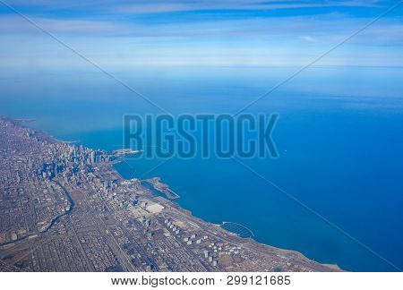 Aerial View Of The Chicago Skyline And Lake Michigan Lakefront As Seen From An Airplane