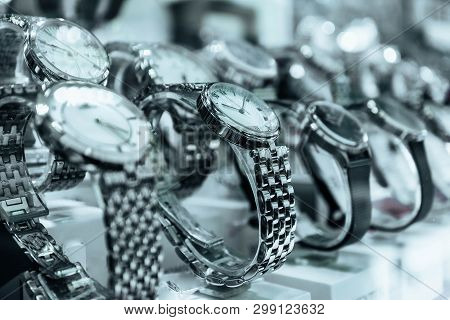 Abstract Watches Store With Metal Bracelet. An Expensive New Female Hand Watch On The Show Case, Clo
